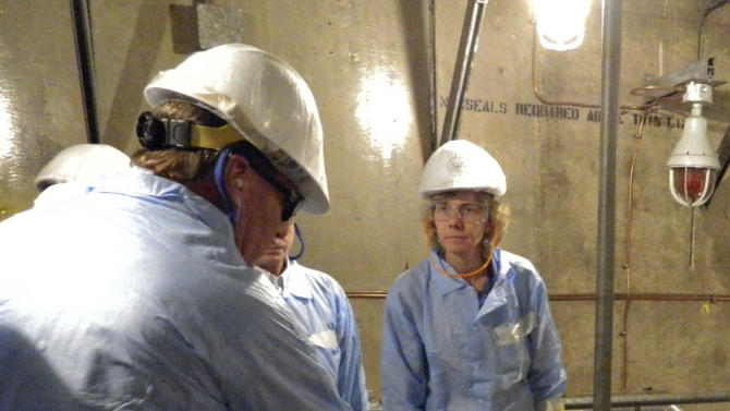 In this photo provided by the Nuclear Regulatory Commission, Allison M. Macfarlane, the chair of the Nuclear Regulatory Commission, listens to San Onofre Nuclear Generating Station staff during a tour of the troubled San Onofre Nuclear Power Station on Monday Jan. 14, 2013 in San Juan Capistrano, Calif. The plant located between Los Angeles and San Diego hasn't produced electricity in nearly a year, after a tiny radiation leak led to the discovery of excessive wear on hundreds of tubes that carry radioactive water. (AP Photo/Nuclear Regulatory Commission)