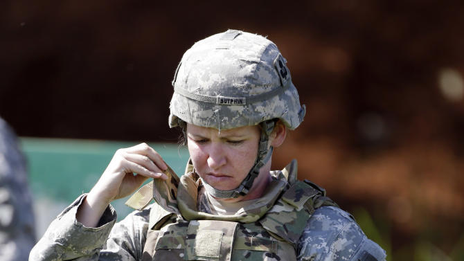 Spc. Sarah Sutphin adjusts her new body armor while training on a firing range on Tuesday, Sept. 18, 2012, in Fort Campbell, Ky. Female soldiers from 1st Brigade Combat Team, 101st Airborne Division are field testing the first Army body armor designed to fit women's physiques in preparation for their deployment to Afghanistan this fall. (AP Photo/Mark Humphrey).