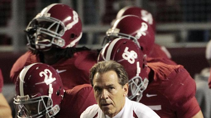 FILE - In this Nov. 18, 2010 file photo, Alabama coach Nick Saban leads his team onto the field for an NCAA college football game against Georgia State at Bryant-Denny Stadium in Tuscaloosa, Ala. Alabama is ranked second, behind Southern California, in the Associated Press preseason college football poll released on Saturday, Aug. 18, 2012. (AP Photo/Dave Martin, File)
