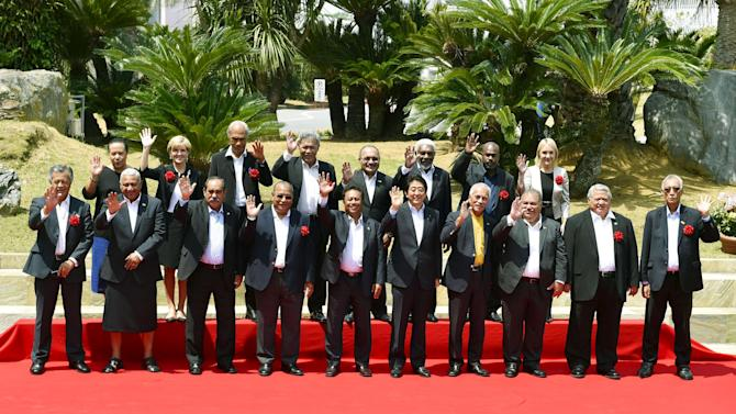 Japan's Prime Minister Shinzo Abe poses for a group photo with leaders from Pacific island nations at the 7th Pacific Islands Leaders Meeting (PALM7) in Iwaki, Japan