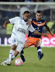 Montpellier's defender Cyril Jeunechamp (R) clashes with Auxerre's forward Roy Contout during their French L1 football match at the Abbe-Deschamps stadium in Auxerre