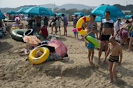 Holiday-makers at the seaside town of Beidaihe, east of Beijing, last summer. International tourist arrivals surpassed one billion for the first time last year, with the Asia-Pacific region posting the biggest increase in foreign visitors, and numbers will rise further in 2013, a UN body said Tuesday