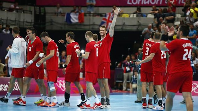 Hungary's Balazs Laluska (C) waves to the crowd after defeating Serbia in their men's handball Preliminaries Group B match at the Copper Box venue during the London 2012 Olympic Games