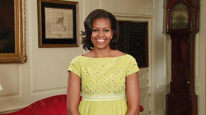 """In this image made from video and provided by Worldwide Pants, Inc., first Lady Michelle Obama presents the """"Top Ten Fun Facts About Gardening,"""" from the Map Room at the White House in Washington. The taped segment will air on the Tuesday, June 5, 2012, telecast of the """"Late Show with David Letterman."""" (AP Photo/Worldwide Pants Inc.) MANDATORY CREDIT; NO ARCHIVE; NO SALES; FOR NORTH AMERICAN USE ONLY"""