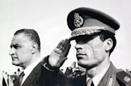 FILE - In this undated 1969 photo, Col. Moammar Gadhafi , right, salutes as he appears with Egypt's Prime Minister Gamal Abdel Nasser, left, in Suez, Egypt. A U.S. official says Libya's new government has told the United States that Moammar Gadhafi is dead. The official said Libya's Transitional National Council informed U.S. officials in Libya of the development Thursday, Oct. 20, 2011. (AP Photo/Farouk Ibrahim)