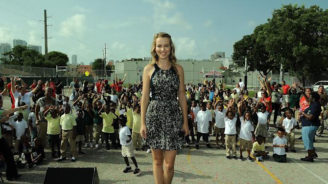 COMMERCIAL IMAGE - Target and Disney Channel actress and Hollywood Records artist, Bridgit Mendler, celebrated with the Phillis Wheatley Elementary School community in Miami on Thursday, Aug. 23, 2012. As part of the Give With Target campaign, Target and Bridgit kicked off the new school year by presenting the school with a $25,000 check, an additional $20,000 in school supplies, and a celebration event. Learn more at http://abullseyeview.com/category/give-with-target/. (Photo by Jeff Daly/Invision for Target/AP Images)