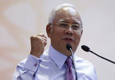 Malaysia's Najib appoints new ministers to strengthen coalition