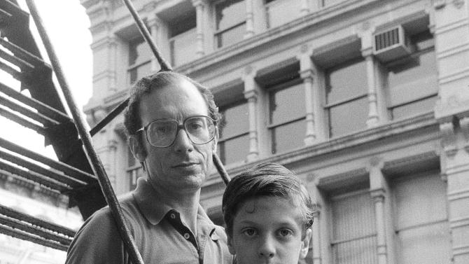FILE - In this May 18, 1985 file photo, Stanly Patz, along with his son Ari, holds a photo of his son Etan, in New York.  Etan Patz vanished in 1979 after leaving his family's SoHo home for a short walk to his school bus stop.   On Thursday, April 19, 2012, investigators began searching a basement near the Patz's apartment for human remains of the boy. (AP Photo/Ron Frehm, File)