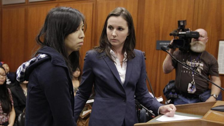 Margaret Ngo, left, stands with her attorney Stephanie Jamieson, right, during her arraignment in a San Jose, Calif., courtroom, Monday, July 16, 2012, as she and three other family members were charged with severely neglecting a dozen mentally disabled adults in their care in an upscale San Jose home. Authorities say inside the house would be the horrific scene of an unkempt, unlicensed care center where a dozen mentally disabled adults were beaten, malnourished and even not allowed to use toilet paper. (AP Photo/Paul Sakuma)
