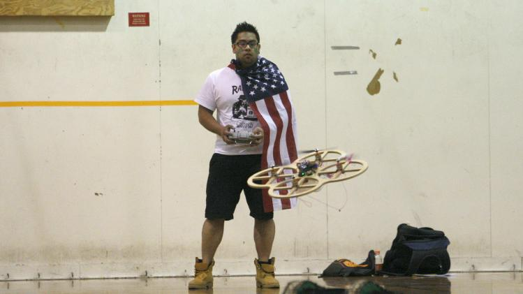 "Avengers team member Hernandez wears a U.S. flag while operating a robot in the ""Raiders of the Lost Can""-themed robotic Engineering Design Contest at Caltech in Pasadena"