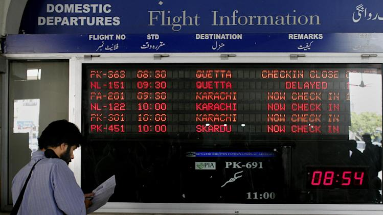 In this Saturday, June 8, 2013 photo, a passenger checks his e-ticket at Benazir Bhutto airport in Islamabad, Pakistan. Most of Pakistan's planes are more than 25 years old and not in the best of shape, its staff is bloated, and every flight is probably costing the state money instead of adding to its bottom line, with the carrier losing some $300 million a year. That's emblematic of the problems with Pakistan's state-owned enterprises, underlining how difficult it will be for Prime Minister Nawaz Sharif to carry out a key promise for rebuilding the economy, rescuing, reforming and possibly privatizing a slew of state companies. (AP Photo/Anjum Naveed)