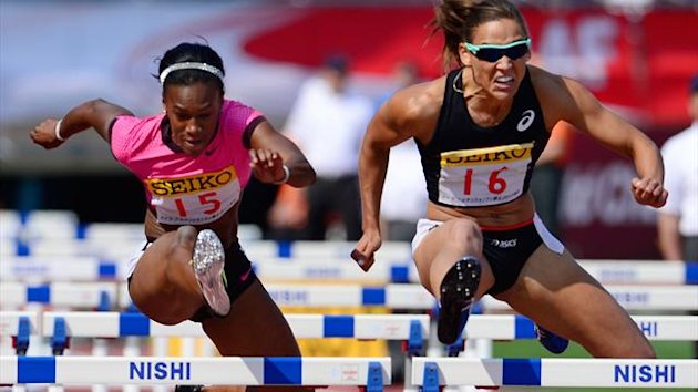 JAPAN, Tokyo : Lolo Jones (R) of the US competes against compatriot Kellie Wells in the women's 100 metre hurdles event during the Seiko Golden Grand Prix in Tokyo on May 5, 2013. Jones won the race in 12.92 seconds (AFP)