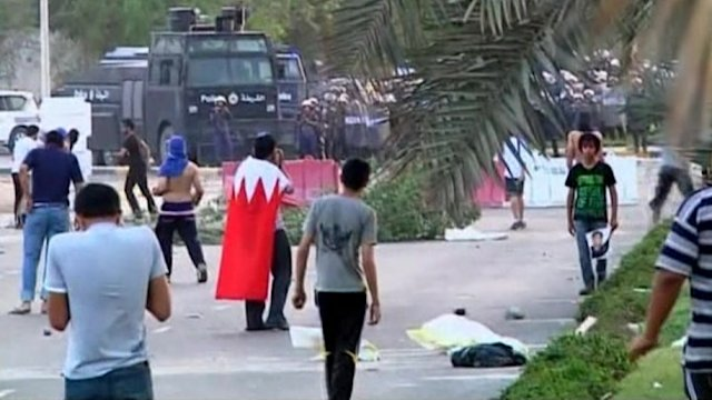 Bahraini protesters clash with police over raid on cleric's home