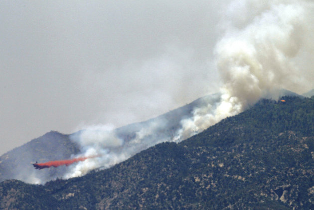 An air tanker drops retardant on a fire Monday, May 14, 2012 near Crown King, Ariz. Fire crews spent the weekend fighting several wildfires in Arizona including the 4.5-square-mile blaze near Crown King. (AP Photo/Matt York)