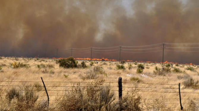 An uncontrolled wildfire burns at the Jeff Davis and Presidio County line near Fort Davis, Texas, Sunday, April 10, 2011. A fast-moving wildfire had spread to more than 60,000 acres in Presidio County and Jeff Davis County, where it destroyed about 20 homes in Fort Davis.  (AP Photo/Billy Marginot)