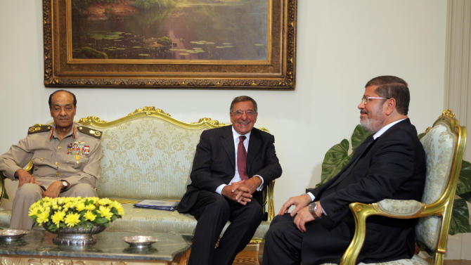 Egypt's newly elected President Mohammed Morsi, right, meets with U.S. defense Secretary Leon Panetta, center, and leader of Egypt's military, Field Marshal Mohammed Hussein Tantawi, left, in Cairo, Egypt, Tuesday, July 31, 2012. Panetta is seeking assurances from Egypt's new Islamist government that the country will remain a military partner at a time of political tumult in the Middle East and growing worry about Iran's nuclear ambitions. (AP Photo/Amr Nabil)