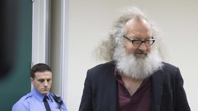 "Actor Randy Quaid, right, is escorted into his Immigration and Refugee Board hearing in Montreal, Thursday, Oct. 8, 2015. Quaid said in an interview that he could be deported from Canada next week and that he would like to resolve his legal issues in California and ""move on with my life."" The actor and his Canadian wife fled the U.S. in 2010, saying they were victims of persecution. (Peter McCabe/The Canadian Press via AP)"