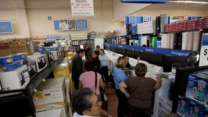 In this Nov. 18, 2011 photo, people shop at a Wal-Mart Superstore in Mexico City. Wal-Mart Stores Inc. hushed up a vast bribery campaign that top executives of its Mexican subsidiary carried out to build stores across Mexico, according to a published report by the New York Times. (AP Photo)