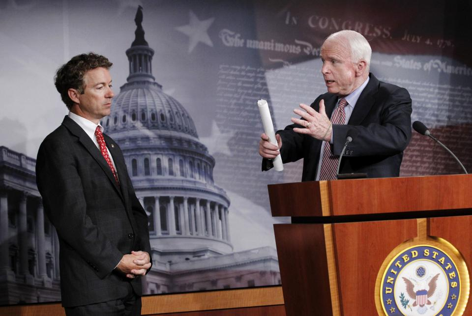 Sen. John McCain, R-Ariz., right, accompanied by Sen. Rand Paul, R-Ky., gestures during a news conference on Capitol Hill in Washington Thursday Oct. 13, 2011, to discuss the introduction of a Republican alternative jobs bill.  (AP Photo/Manuel Balce Ceneta)