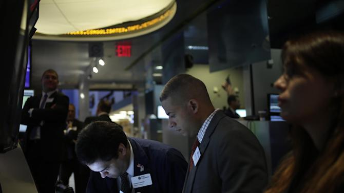 FILE - In this Tuesday, Sept. 3, 2013, file photo, traders work on the floor at the New York Stock Exchange in New York. World stock markets were muted Thursday Sept. 12, 2013 as investors kept their guard up ahead of the release of U.S. retail sales data and next week's Federal Reserve policy meeting. (AP Photo/Seth Wenig, File)