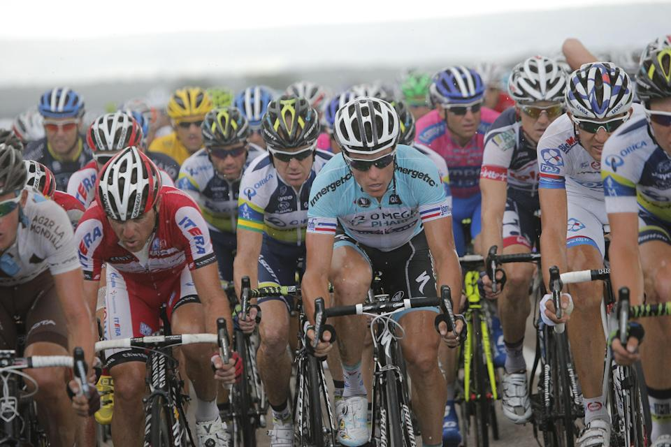 Sylvain Chavanel of France, center in light blue jersey, rides in the pack during the sixth stage of the Tour de France cycling race over 207.5 kilometers (129 miles) with start in Epernay and finish in Metz, France, Friday July 6, 2012. (AP Photo/Christophe Ena)