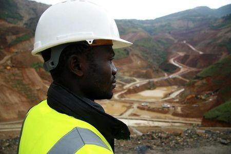An employee stands in an open pit at Banro's Twangiza mine in eastern Congo