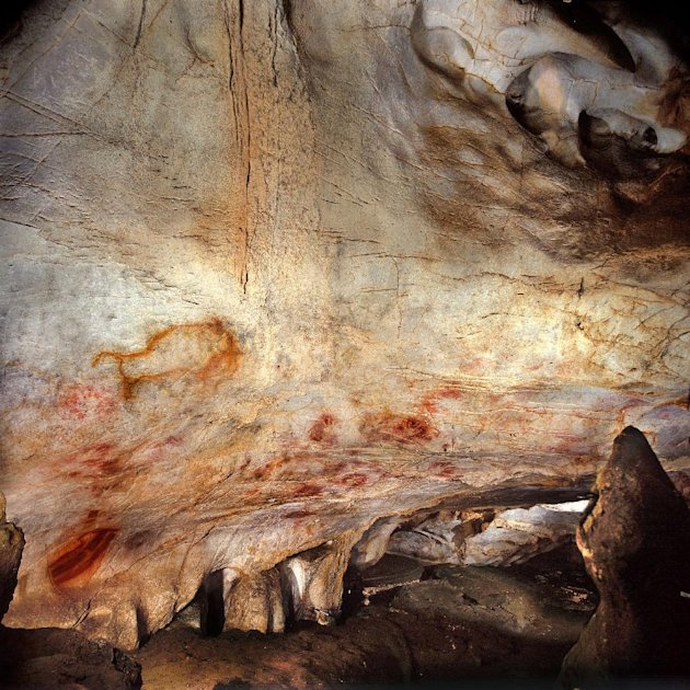 This undated handout photo provided by pedro suara/aaas shows the 'Panel of Hands', El Castillo Cave showing red disks and hand stencils made by blowing or spitting paint onto the wall. A date from a