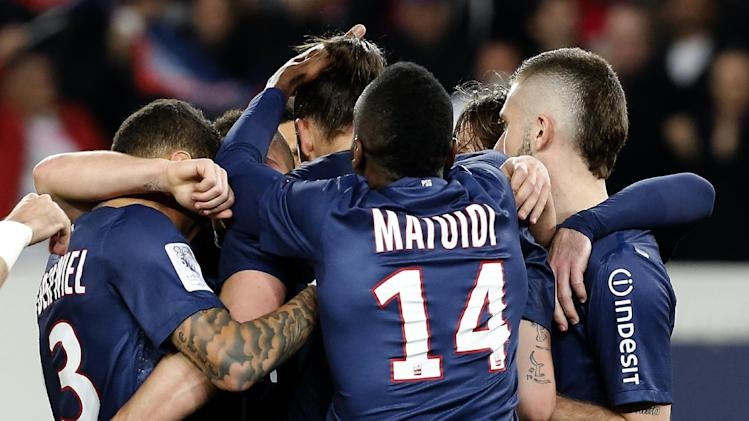 Paris Saint Germain's Zlatan Ibrahimovic, center, is congratulated by teammates after scoring against OGC Nice during their French League One soccer match Sunday, April 21, 2013, in Parc des Princes stadium, in Paris, France. (AP Photo/Jacques Brinon)