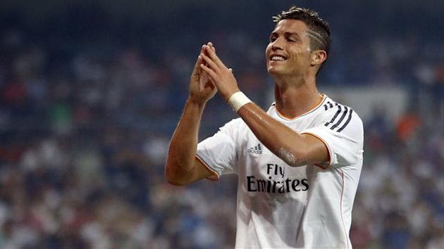 Real Madrid's Cristiano Ronaldo reacts after missing a chance to score against Real Betis during their Spanish first division soccer match at Santiago Bernabeu stadium in Madrid August 18, 2013. REUTERS