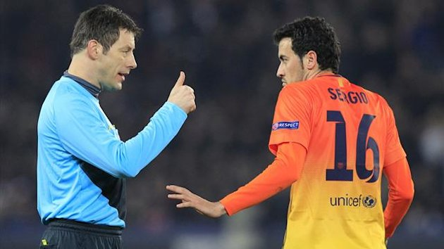Referee Wolfgang Stark (L) warns Barcelona's Sergio Busquets during their Champions League quarter-final first leg against Paris St Germain at the Parc des Princes (Reuters)