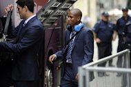 England national football team player Ashley Young leaves the Hotel Stary in Krakow a day after their defeat at the Euro 2012 football championships quarter-final match against Italy