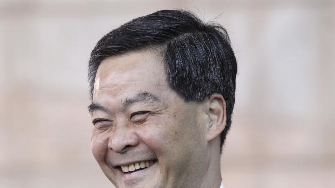 Former convener of Hong Kong's Executive Council Leung Chun-ying smiles to the election committee members at a polling station in Hong Kong, Sunday, March 25, 2012. Hong Kong's elite voted Sunday for the city's next leader following a tumultuous, bitter race that highlighted public discontent in the southern Chinese financial hub. (AP Photo/Kin Cheung)