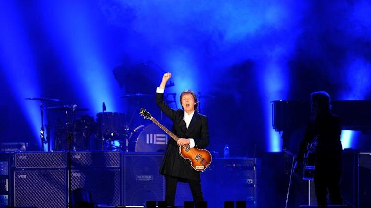 "Paul McCartney performs during the opening concert of his ""Out There"" tour on April 19, 2014 in Montevideo"