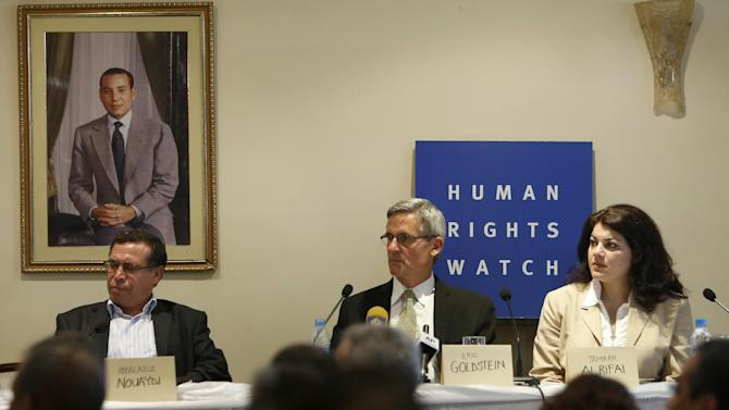 Abdelaziz Nouaydi, President of the Adala Association, left, Eric Goldstein, centre, deputy director of Human Rights Watch's Middle East and North Africa division, and Tamara Al Rifai, right, Director, Advocacy and Communications Middle East and North Africa, right, attend a news conference given by Human Rights Watch in Rabat, Morocco, Friday, June 21, 2013. Human Rights Watch says in a new report that Morocco's justice system overly relies on coerced confessions and needs serious reform. (AP Photo/Abdeljalil Bounhar)