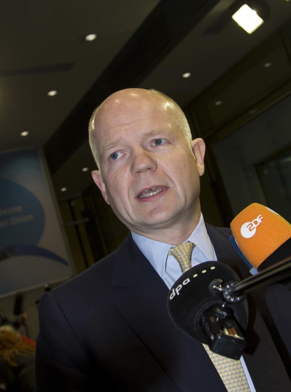 British Foreign Minister William Hague speaks with the media as he arrives for a meeting of EU Foreign Ministers in Luxembourg on Monday Oct. 15, 2012. Britain, Germany and France say they expect the European Union to approve even tougher sanctions on Iran to prevent it from developing nuclear weapons. (AP Photo/Virginia Mayo)