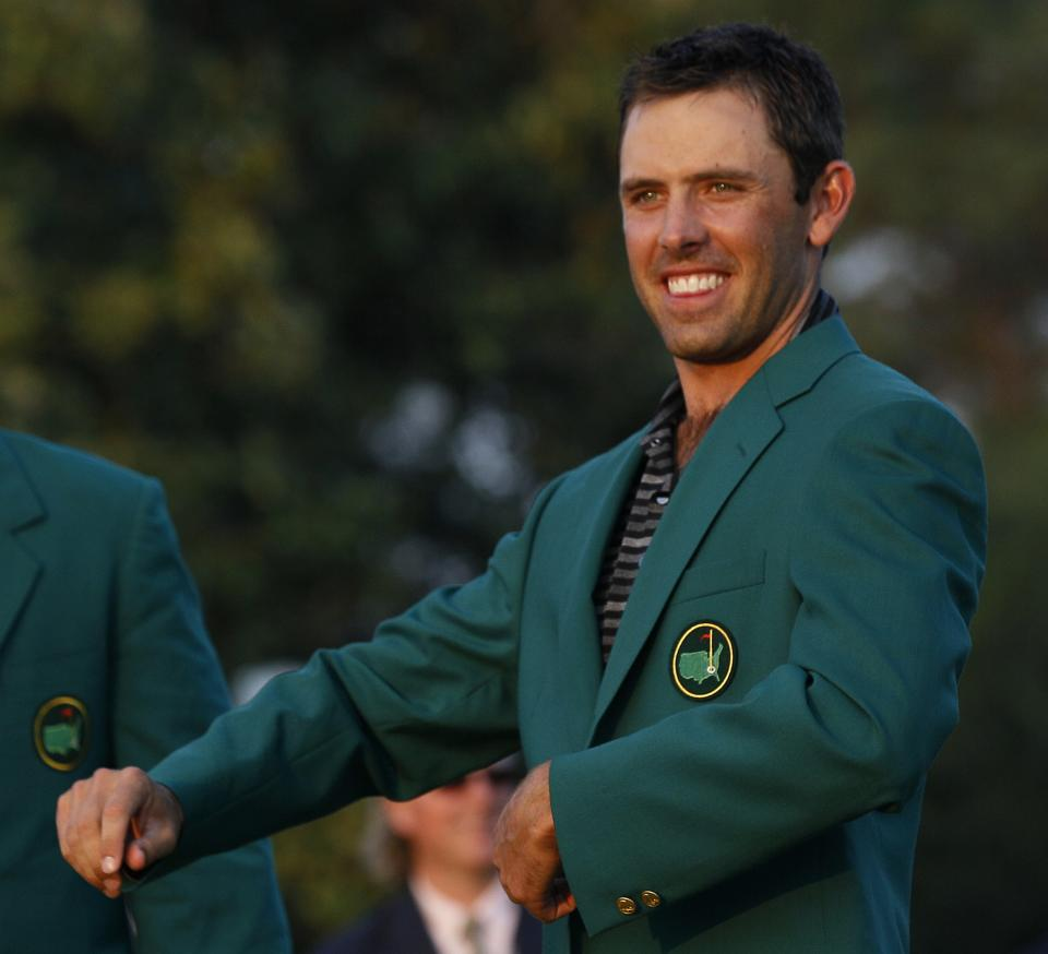 Charl Schwartzel of South Africa shows off his green jacket after winning the Masters golf tournament Sunday, April 10, 2011, in Augusta, Ga. (AP Photo/David J. Phillip)