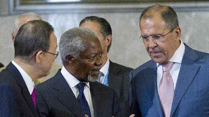 FILE - In this June 30, 2012 file photo, Kofi Annan, Joint Special Envoy of the United Nations and the Arab League for Syria, center, speaks with U.N. Secretary-General Ban Ki-moon, left, and Russian Foreign Minister Sergei Lavrov before the start of the Action Group on Syria meeting at the United Nations in Geneva, Switzerland. Annan said Thursday, Aug. 2, 2012 he will step down from his high-profile role as special envoy for Syria at the end of the month, delivering blistering criticism of world powers' failure to unite over the country's escalating violence. (AP Photo/Haraz N. Ghanbari, Pool, File)