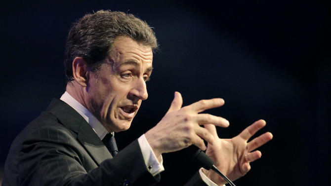 France's President and candidate for re-election in 2012, Nicolas Sarkozy, gestures as he delivers a speech during a campaign meeting in Toulouse, western France, Sunday, April 29, 2012. (AP Photo/Michel Euler)