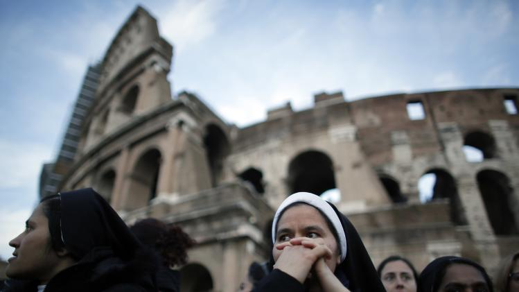 A nun prays before Pope Francis leads a Via Crucis (Way of the Cross) procession during Good Friday celebrations in front of the Colosseum in Rome