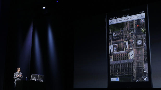 Scott Forstall, Apple's senior vice president of iOS Software, demonstrates a new mapping feature showing Big Ben in London during an introduction of the new iPhone 5 in San Francisco, Wednesday Sept. 12, 2012.  (AP Photo/Eric Risberg)