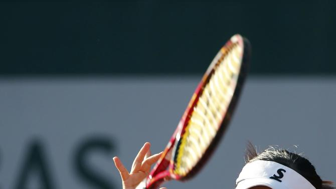 Misaki Doi of Japan plays a shot to Ana Ivanovic of Serbia during their the women's singles match at the French Open tennis tournament at the Roland Garros stadium in Paris