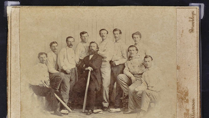 FILE - This undated file photo released Wednesday, Jan. 9, 2013 by the Saco River Auction Co., in Biddeford, Maine, shows a rare 1865 baseball card of the Brooklyn Atlantics, discovered in a photo album bought at a yard sale in Baileyville, Maine, on the Canadian border. The auction house expects six-figure bids at its Feb. 6 auction. (AP Photo/ Saco River Auction Co., File)