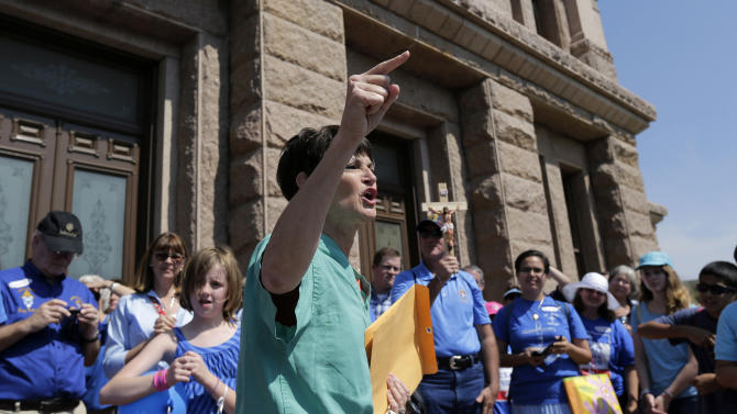 Sen. Donna Campbell, R-New Braunfels, speaks to an anti-abortion group outside the state capitol, Monday, July 1, 2013, in Austin, Texas. The Texas Senate has convened for a new 30-day special session to take up contentious abortion restrictions bill and other issues. (AP Photo/Eric Gay)