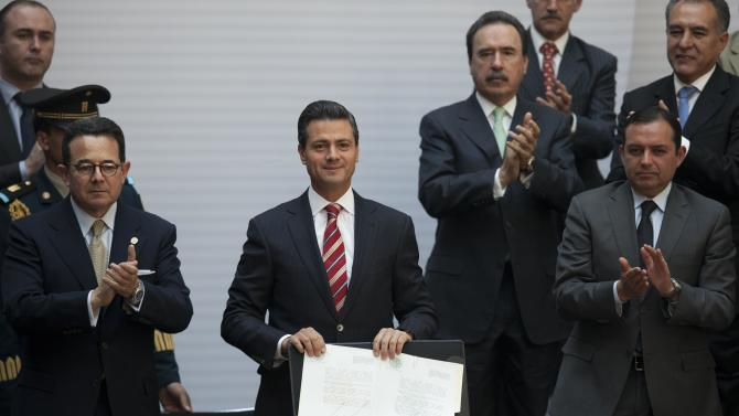 Mexican president signs education reform