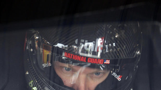 Dale Earnhardt Jr., gets set for his first practice since recovering from concussions at Martinsville Speedway in Martinsville, Va., Friday, Oct. 26, 2012.  (AP Photo/Steve Helber)