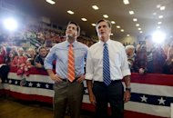 US Republican Presidential candidate Mitt Romney (R) and his running mate Paul Ryan (L) during a rally at the Veterans Memorial Coliseum in Marion, Ohio on October 28. US President Barack Obama raced back to the White House Monday ahead of Hurricane Sandy, which threw election endgame plans into turmoil just one week before he asks Americans for a second term