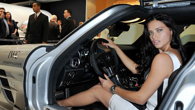 IMAGE DISTRIBUTED FOR IWC SCHAFFHAUSEN  -  Adriana Lima  visits the IWC booth during the Salon International de la Haute Horlogerie (SIHH) 2013 at Palexpo in Geneva, Switzerland on Jan. 22, 2013. (Image Gate/Photopress for IWC via AP Images)