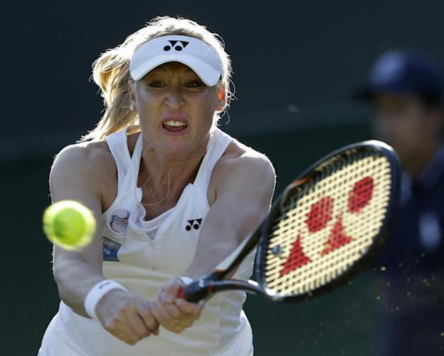 This is a Thursday June 28, 2012 file photo of Elena Baltacha of Britain as she returns a shot  to Petra Kvitova of the Czech Republic during a second round women's singles match at the All Englan