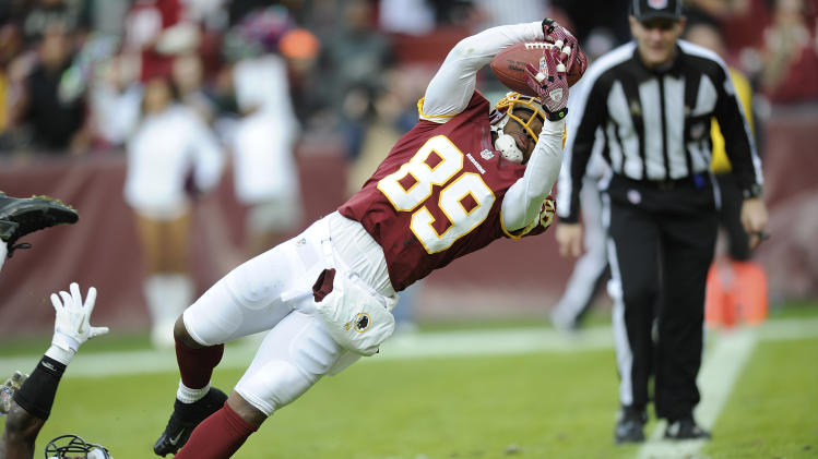 Washington Redskins wide receiver Santana Moss (89) slips out of the grasp of Philadelphia Eagles cornerback Brandon Boykin to score a touchdown during the second half of an NFL football game in Landover, Md., Sunday, Nov. 18, 2012. (AP Photo/Nick Wass)