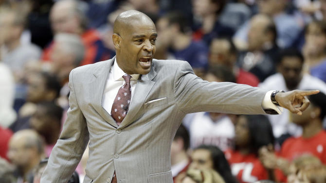 Atlanta Hawks head coach Larry Drew speaks to players during the first half in Game 3 of their first-round NBA basketball playoff series against the Indiana Pacers, Saturday, April 27, 2013 in Atlanta. (AP Photo/John Bazemore)